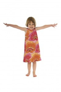 Little girl, LeapSmart student, in floral dress with arms outstretched